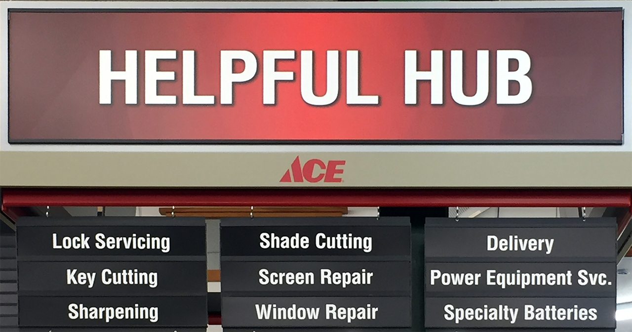 "Ace ""Helpful Hub"" sign with services"